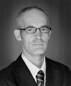 Bruno Quinquet as director. 2011 black and white formal portrait.